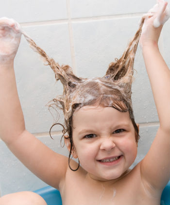 child washes hair