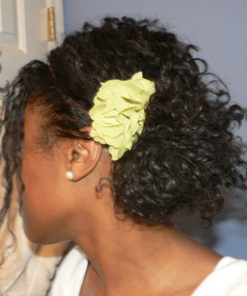 curly hair with flower pin