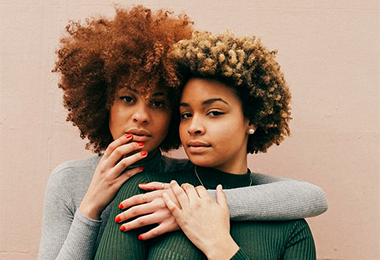 2 black girls with blonde kinky curly natural hair