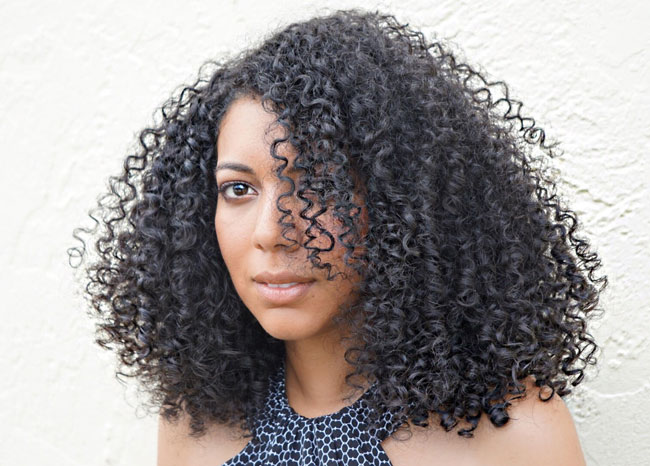 bloused triangle shape curly haircut